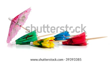 colorful drink umbrella toothpicks on a white background