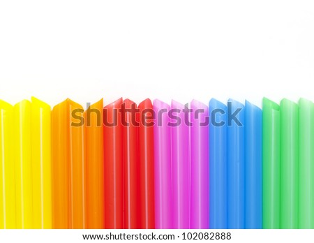Colorful drinking straws background and copy space