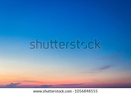 colorful dusk sky in the evening on twilight,amazing majestic blue sky,idyllic sunlight on sunset background #1056848555