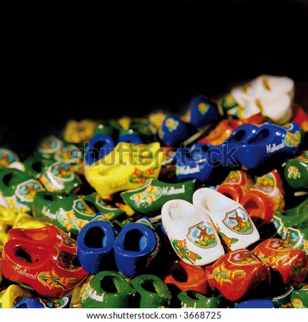 colorful dutch wooden shoes with shallow depth of field on black background