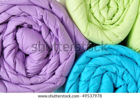 Colorful duvets.