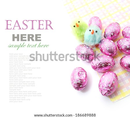 Colorful Easter chocolate eggs with little Easter chicken isolated on white  #186689888