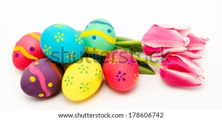 Colorful easter eggs and flowers isolated on a white background
