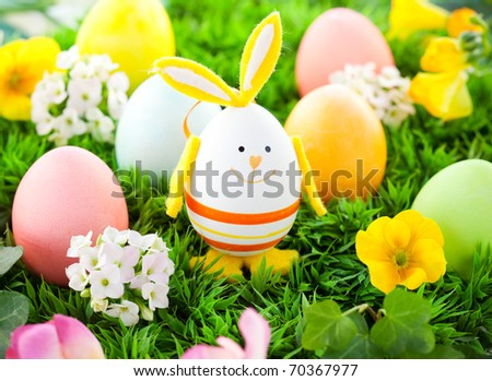 colorful Easter Eggs and rabbit on the grass