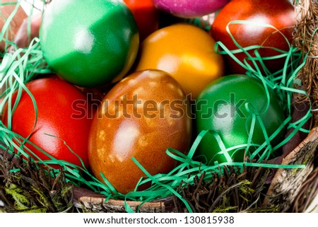 Colorful Easter eggs basket closeup