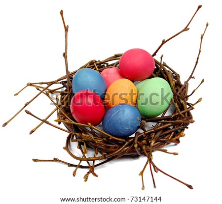 Colorful  Easter eggs in a nest from branches on a white background