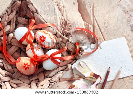 Colorful Easter eggs in basket on rustic wooden background/Easter day concept