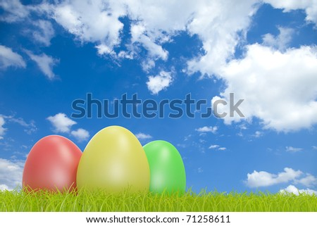 Colorful easter eggs in front of a cloudy sky with COPYSPACE