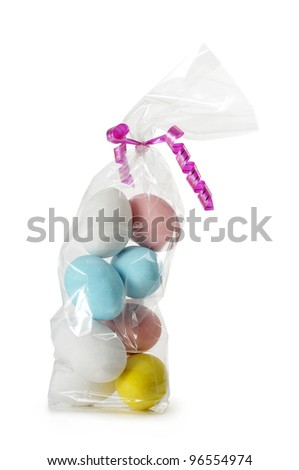 colorful easter eggs in plastic bag, isolated on white