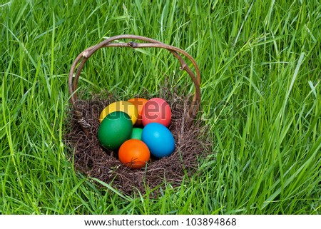Colorful Easter eggs in the brown basket.