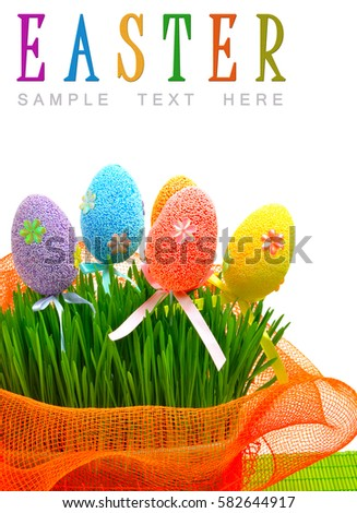 Colorful easter eggs in the flowerbed wih green fresh grass isolated on white #582644917