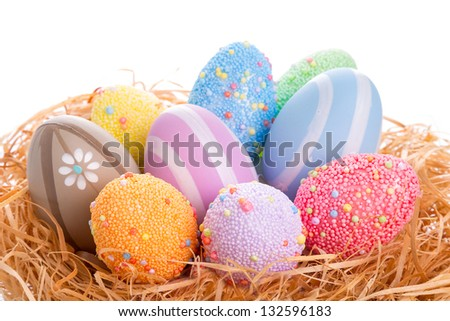 Colorful Easter eggs in the nest over white background - stock photo