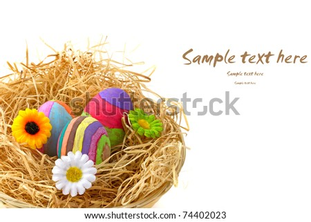 Colorful Easter eggs on hay in the basket