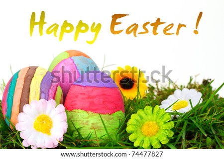 Colorful Easter eggs on the grass with flowers