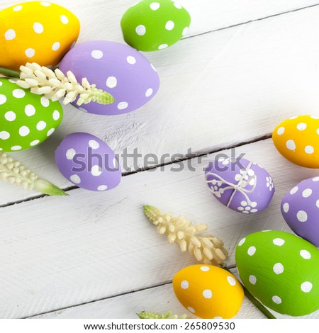 Colorful Easter Eggs on White or Gray Rustic Wood Background