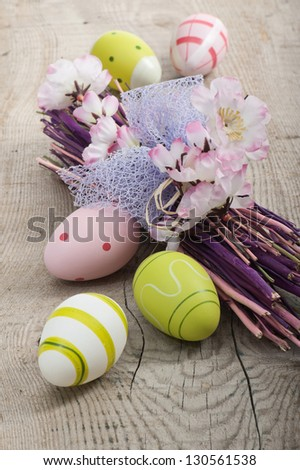 colorful easter eggs with flowers on wood