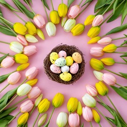 Colorful easter quail eggs in nest and tulips on pink background with . Flat lay. Spring composition. Happy easter greeting card.