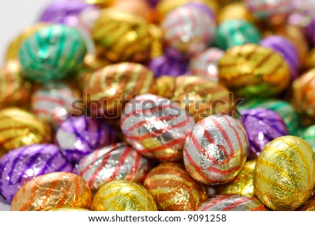 Colorful eastereggs in pink, yellow, purple and green.