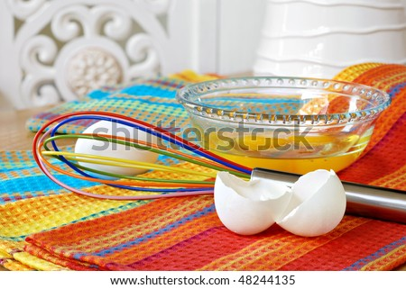 Colorful Egg Whisk With Bowl Of Fresh Eggs And Eggshells On ...