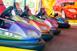 Colorful electric bumper car in autodrom in the fairground attractions at amusement park. Selective focus on the cars