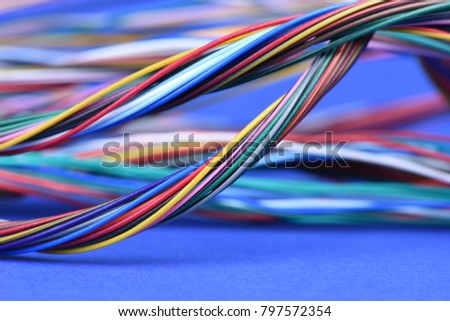Colorful electrical cables on blue background #797572354