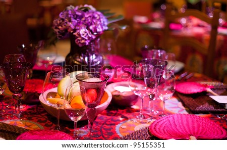 Colorful elegant dinner table setting.
