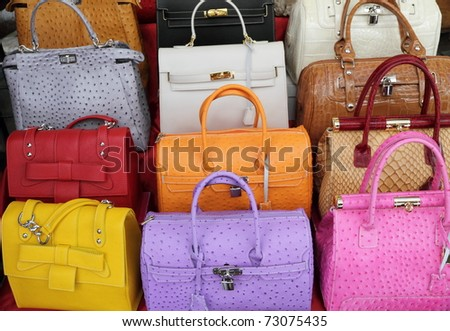 colorful elegant leather hand bags collection on Mercato di San Lorenzo ( Mercato Centrale ) in Florence, Italy, Europe