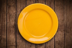 Colorful empty shiny plate on grungy background table