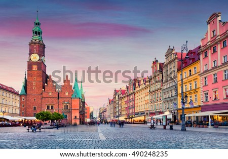 Colorful evening scene on Wroclaw Market Square with Town Hall. Sunset in historical capital of Silesia, Poland, Europe. Artistic style post processed photo. #490248235