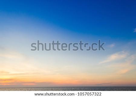 colorful evening sky on twilight over sea,majestic sunset sky background #1057057322