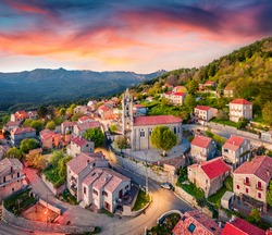 Colorful evening view from flying drone of Zonza town, commune in the Corse-du-Sud department of France. Astonishing sunset on Corsica island, France, Europe. Traveling concept background.