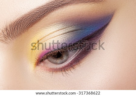 Colorful eye makeup closeup.