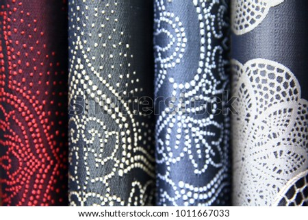 Colorful fabric is used to design out all kinds of clothes for women and men, it can be canvas or cotton, and even silk all suitable for clothes.  #1011667033