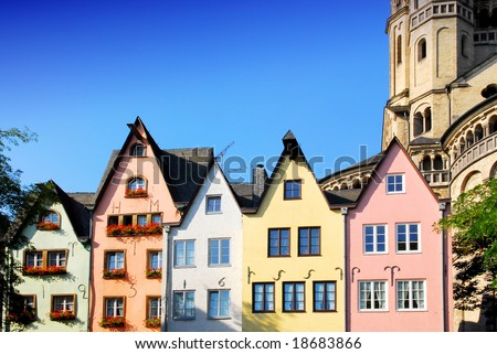 Colorful facade of houses at St. Martin's church in Cologne, Germany