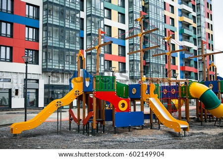 Colorful facades of modern residental construction. Ventilated facade systems, public area improvement works #602149904