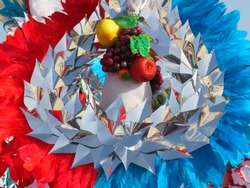 Colorful fantasy headdress background with feathers, fruits and silver glittering garlands. Fantasy headdresses pattern.