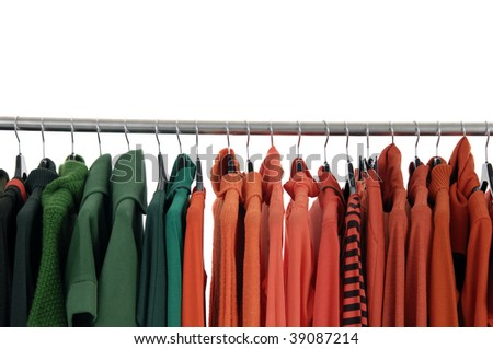 Colorful female coat on hangers at the show #39087214