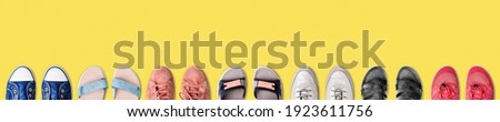 Colorful female shoes collection yellow background close up top view, women fashion sneakers, stylish gymshoes, summer sandals set, sport and casual walking footwear, shoe shop, store sale, copy space Photo stock ©