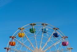 Colorful ferris wheel agains clear blue sky in Tibidabo mountain. Barcelona, Catalonia, Spain