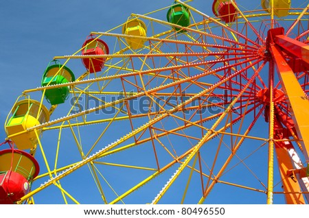 Colorful ferris wheel and blue sky