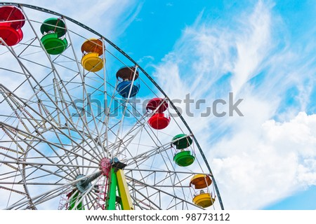 Colorful ferris wheel on blue sky background, Moscow, Russia, East Europe