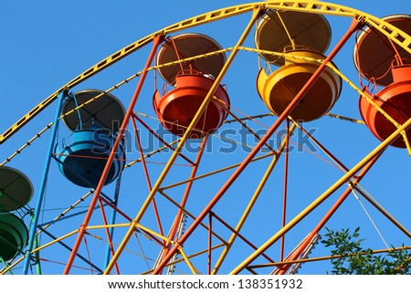 colorful ferris wheel on the park in the sunshine summer say