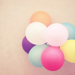Colorful festive balloons on wall with retro instagram filter effect