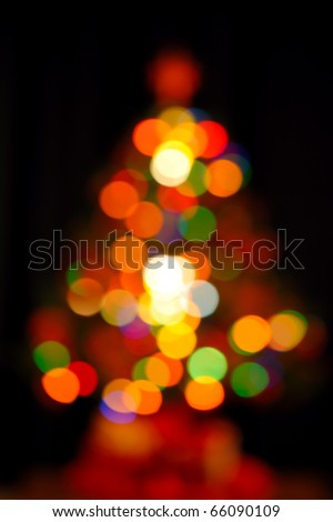 colorful fir shape christmas light on dark background - stock photo