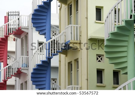 colorful fire escapes at the back of traditional chinese shop houses in singapore city state