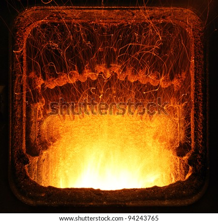 Colorful fire in industrial furnace.