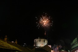 Colorful Firework lights in the night sky. Fireworks show above Old bridge and Old town Mostar.
