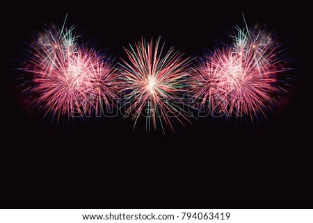 Colorful firework on the night sky. New Year celebration fireworks. Abstract firework isolated on black background with free space for text #794063419