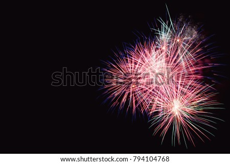 Colorful firework on the night sky. New Year celebration fireworks. Abstract firework isolated on black background with free space for text #794104768