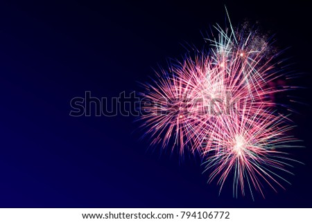 Colorful firework on the night sky. New Year celebration fireworks. Abstract firework isolated on the transition of blue and black background with free space for text #794106772